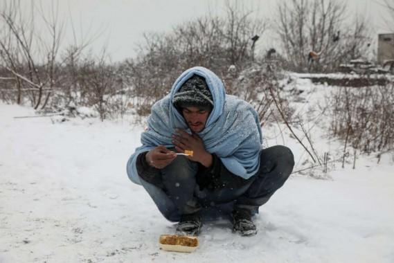 migranti foto numero 2