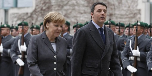 German Chancellor Merkel and Italian Prime Minister Renzi inspect guard of honour before German-Italian government consultations in Berlin