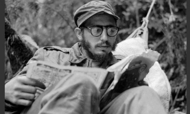 Cuban guerrilla leader Fidel Castro does some reading while at his rebel base in Cuba's Sierra Maestra mountains in this 1957 photo. (AP Photo/Andrew St. George)