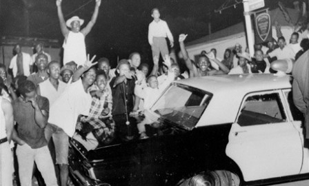 ** FILE ** Demonstrators push against a police car after rioting erupted in a crowd of 1,500 in the Los Angeles area of Watts in this file photo taken August 12, 1965. The 40th anniversary of the start of the six-day uprising is Thursday, Aug. 11. (AP Photo/File)